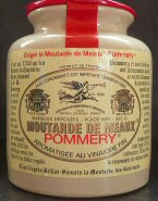Een pot graanmosterd Moutarde de Meaux